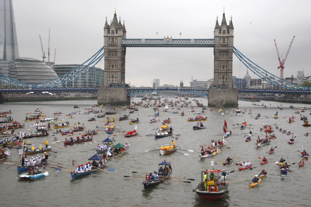 Hundreds of vessels pass Tower Bridge during Her Majesty the Queen's Diamond Jubilee River Pageant in London in June 2012.  The Royal Navy was out in force on Sunday 3rd June  with the Senior Service pulling out all the stops to celebrate the QueenÕs Diamond Jubilee at the River Pageant. The Queen and several members of the Royal Family took part in a flotilla of 1,000 boats sailing along the River Thames from Battersea Bridge to Tower Bridge. Accompanying the Royal Barge containing Her Majesty The Queen and His Royal Highness The Duke of Edinburgh will be the Royal Barge Honour Guard (RBHG) made up of two P2000 patrol boats, two Picket Boats, two Rigid Inflatable Boats from HMS Diamond, and four Off-shore Raiding Craft from 539 Assault Squadron Royal Marines. Here you can see some of the ships participating passing under tower bridgeunder tower bridge.